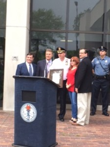 Mayor and councilpersons, past and present, honor Chief Caruso with a proclamation.